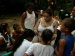 Sally Hippolite and children from the community making a mural at the clinic in Manzanillo