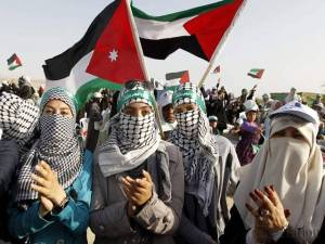 jordanian-action-front-members-hold-a-palestinian-flag-during-a-protest-in-the-dead-sea-area-near-4493