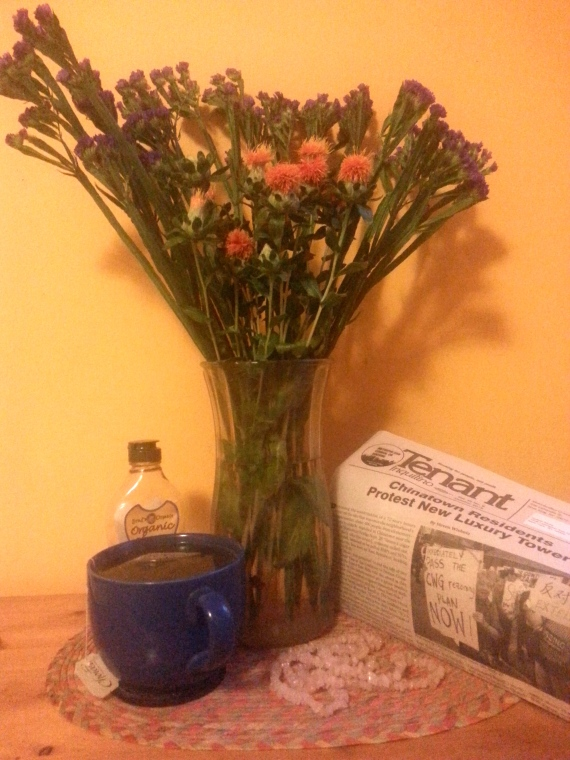 Exorcising the Housing Court energy!  Flowers, crystal necklace, organic ginger jasmine green tea and honey, fighter for accessible and afforable housing literature!